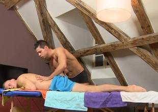 Male masseur is delighting a bulky joyous bear