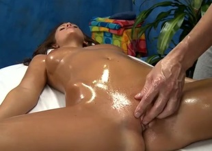 Oiled up Whitney Westgate fucked on a rub-down trustees
