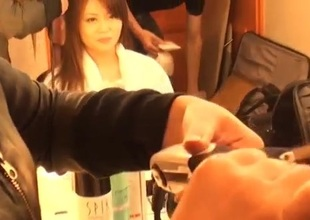 Nao plays there her creamy vag during hot porn show
