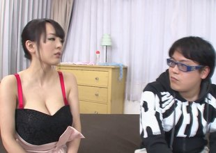 Very busty Asian infant jerks a guy off forth her fat melons