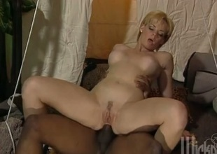 Short haired blonde nuisance fucked by inky tribesman's bushwa