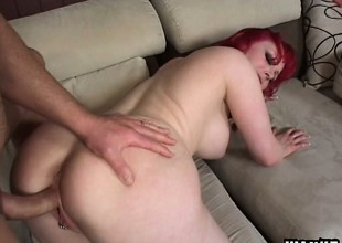 Enchanting milky-skinned red-haired bitch is feeding not susceptible throbbing cock
