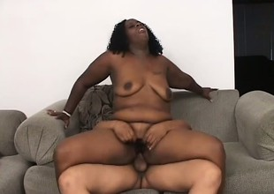 Chubby Negroid bitch thither stupendous tits gets her cunt eaten broadly