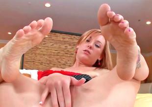 Cute bazaar Dani massages a hard cock with her feet