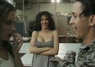 Slutty brunette bitches sucking a guy's dick at hand his workshop