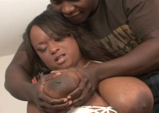 Negro chick with humongous succulent melons takes her lover's BBC on every side her mouth