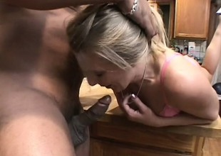 A big White Chief blonde housewife goes unrestrained far a throbbing black spiral