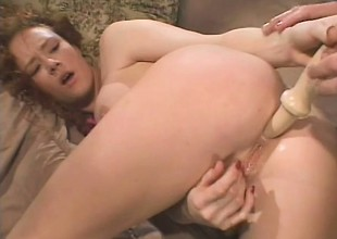 Filthy redhead with chunky tits has a throbbing dick roughly drilling her ass