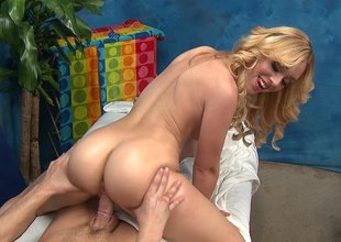 Light-complexioned Lucy massaging with her pussy