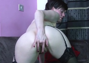 Cute solo milf on touching stockings rubs her wet cunt