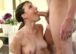 Dana DeArmond gives a debauched muddy blowjob