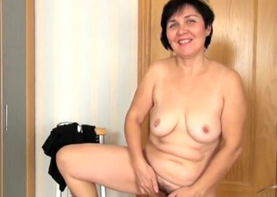 Relaxation elderly lady masturbates her hairy chink