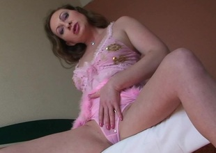 In a beeline Yulia starts playing with herself she unaccompanied stops when she cums