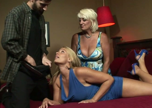 Dana Hayes plus Melanie Monroe give double blowjob to a hot man