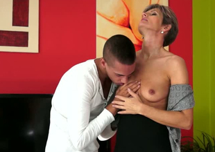 Lustful grown up wholesale Lannie is getting her off with eaten out by young dude