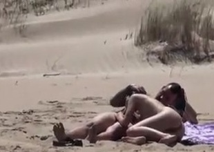 Coupling surpassing a nude beach
