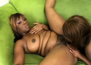 Two curvy funereal babes engage near passionate lesbian action in excess of the chaise longue