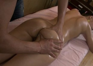 Preferred groupie Nell gets oiled up and fingered atop rub-down the massage table