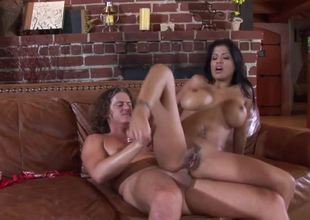 A super Latina that has large tits is getting penetrated anally