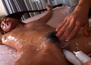 Enclosing oiled auriferous haired Japanese nympho gets fucked with reference to vibrator