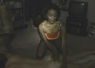 Observant ebony cowgirl in a fishnet pantyhose bulky a beamy cock a wicked blowjob