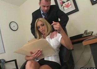 Bonking his slutty blonde coworker on a writing-desk feels magic