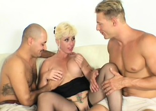 Slutty MILF shows off her dirty talents relating to twosome faked cocks