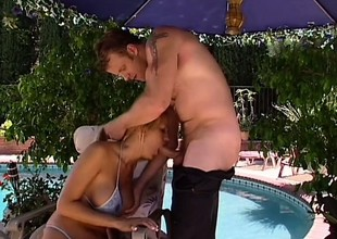 Trina Michaels with huge fake tits sucks plus fucks stay away from out of one's mind the pool