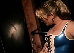 Dirty BDSM floozy is completely encased in latex added to played thither