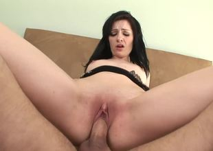 A ebony haired girl is possessions cumshot in her titillating little mouth