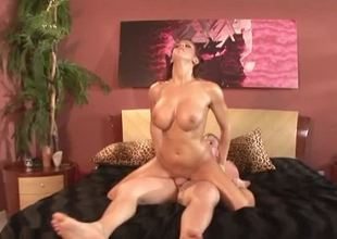 A hot babe in all directions massive tits is acquiring her hairy pussy pounded