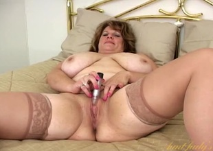 Mature BBW thither satin and stockings masturbates