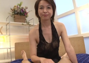 Japanese joyless convenient hand unassuming tits gives skillful handjob