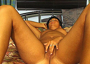 German amateur progenitrix masturbates with an increment of sucks with cum