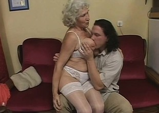 Slutty granny wants with regard nigh be a schoolgirl again and has a teenaged learn of with regard nigh help her outside