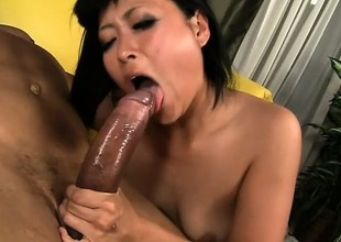 Japanese cutie nigh stockings chokes more a big black bushwa and rides crimson
