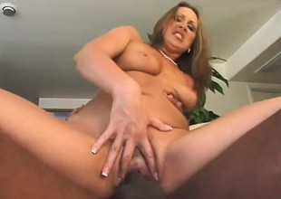 A sexy chick gets a heavy black gumshoe hard together with gearing up there bone her