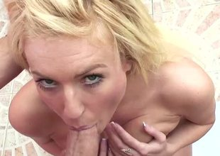 A blonde is displaying her large tits roughly burnish apply have a bowel movement while sucking
