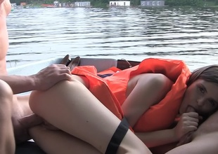 Hardcore on a boat near a cutie in a life vest